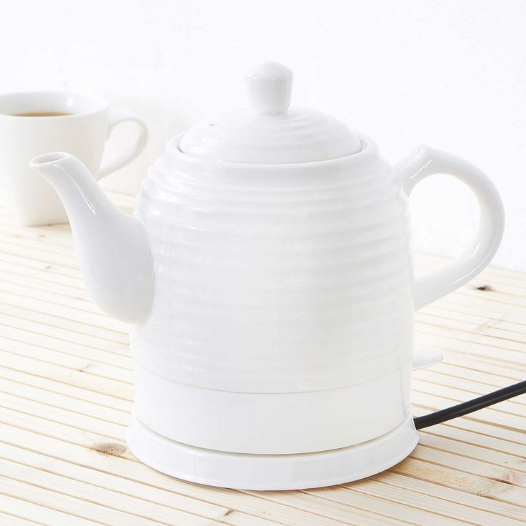 Vintage Ripple White Ceramic Kettle | Dunelm £29.99 There are a lot of ceramic kettles that are heavily decorated - like this one because it is plain white with a ripple texture.  Something appealingly quirky about having what appears to be a thrown ceramic teapot that's electric.