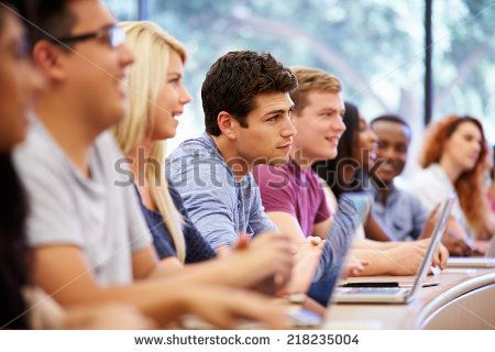 Class Of University Students Using Laptops In Lecture - stock photo