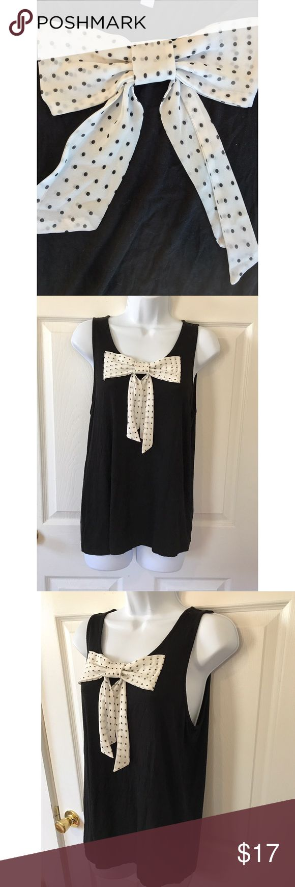 ELLE Cute bow tank top Adorable black tank top adorned with a sheer polka dot bow. Elle Tops Tank Tops
