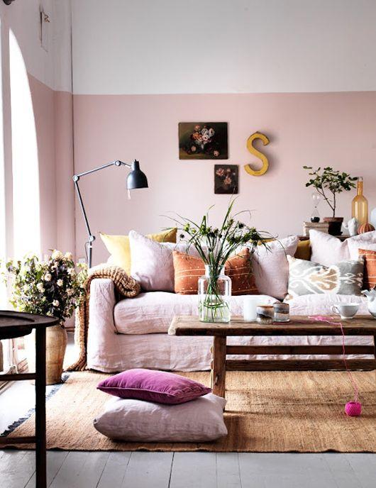 soft pink walls, skirted sofa, layered look