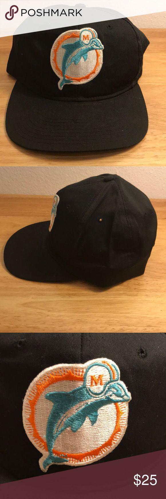 Vintage New Era Miami Dolphins Black Hat Vintage New Era Miami Dolphins Black Hat, Brand New, Never Worn or Used, 🎄WILL SHIP IN ONE DAY🎄All bundles of 2 or more receive 20% off. Closet full of new, used and vintage Vans, Skate and surf companies, jewelry, phone cases, shoes and more. New Era Accessories Hats