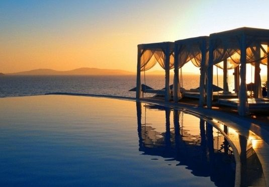 Saint John Mykonos Hotel | Mykonos, Greece | A sun-drenched stay at a luxurious resort on a private beach, with a welcome drink and a dinner option