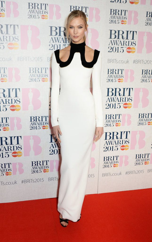 Celebrities at the BRIT Awards 2015 | Pictures | POPSUGAR Fashion UK. Karlie Kloss Cutout shoulders and a black trim added a sexy touch to Karlie's white column dress by Tom Ford.
