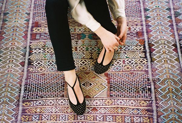 Buh-bye boring black flats! These from Marais have flattering T-straps (they make your foot look narrower), plus they're covered in cool gold studs.
