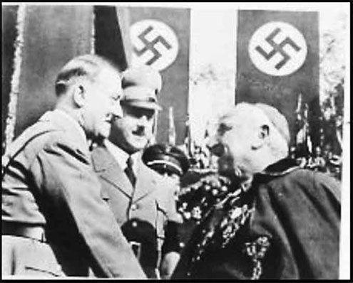 Hitler and Catholic Papel Nuncio Archbishop Orsenigo.  The catholic church helped the nazis escape after war. Terrible.