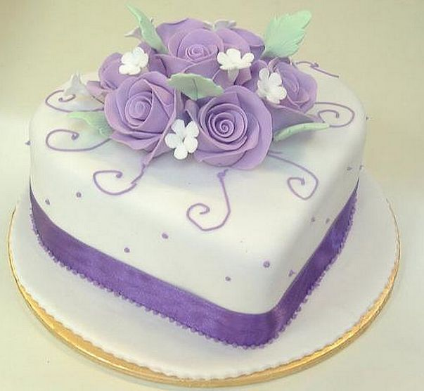 Heart shape engagement cake with purple flowers cake topper.PNG