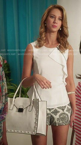 Petra's white ruffled top with printed shorts and white studded bag on Jane the Virgin. Outfit Details: http://wornontv.net/48610/ #JanetheVirgin