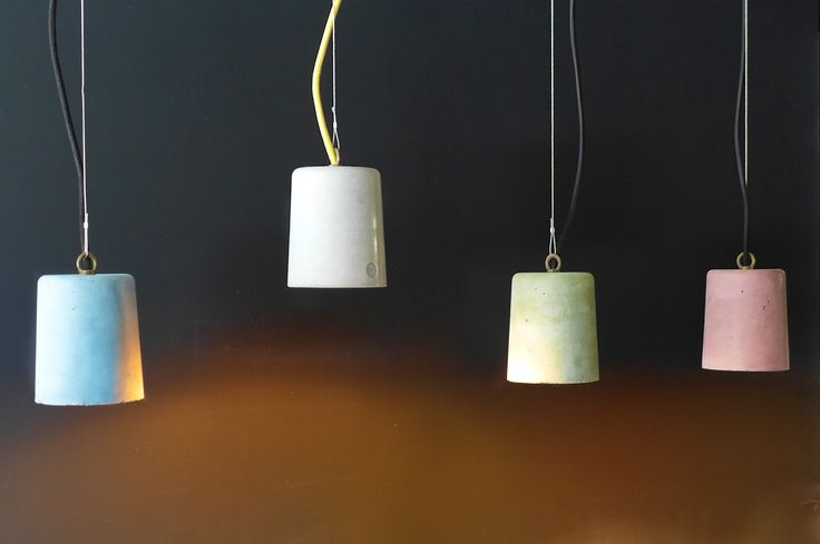 Sunseed. Composition of hand made pendant lamps from concrete