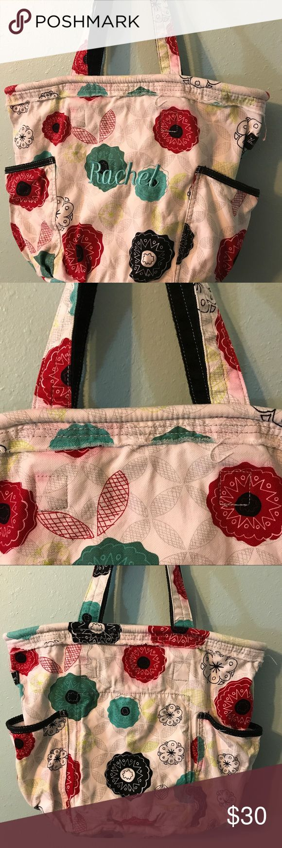 "Thirty One ""Rachel"" Tote Handbag Very cute Large Thirty One ""Rachel"" Tote Handbag!!! This was used a couple times for vacation. I'm selling items I no longer use. There is a zippered pocket and two open pockets  There is also a clip inside for keys. I did wash this bag, which I shouldn't have done, and now around most of the Red Flowers there is bleeding (shown in the pictures). 😕 It is a great bag and very roomy!!! Lots of life left! Bundle and save! Or make an offer! Smoke free home…"