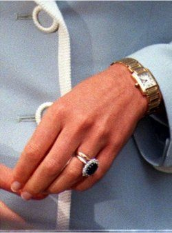 Princess Diana wearing Cartier Gold Tank Francaise watch and her famous sapphire and diamond engagement ring. .... ..Uploaded By  www.1stand2ndtimearound.etsy.com