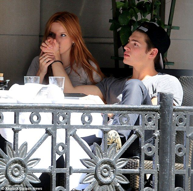 Kiss kiss: They first stopped to have an al fresco lunch at a Japanese restaurant where sh...