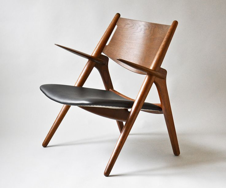 Hans J. Wegner (1914-2007). Sawhorse chair model CH-28. Frame in solid stained oak , seat upholstered in black leather. Shaped in 1951. Manufactured by Carl Hansen & Søn. #Wegner #CH28