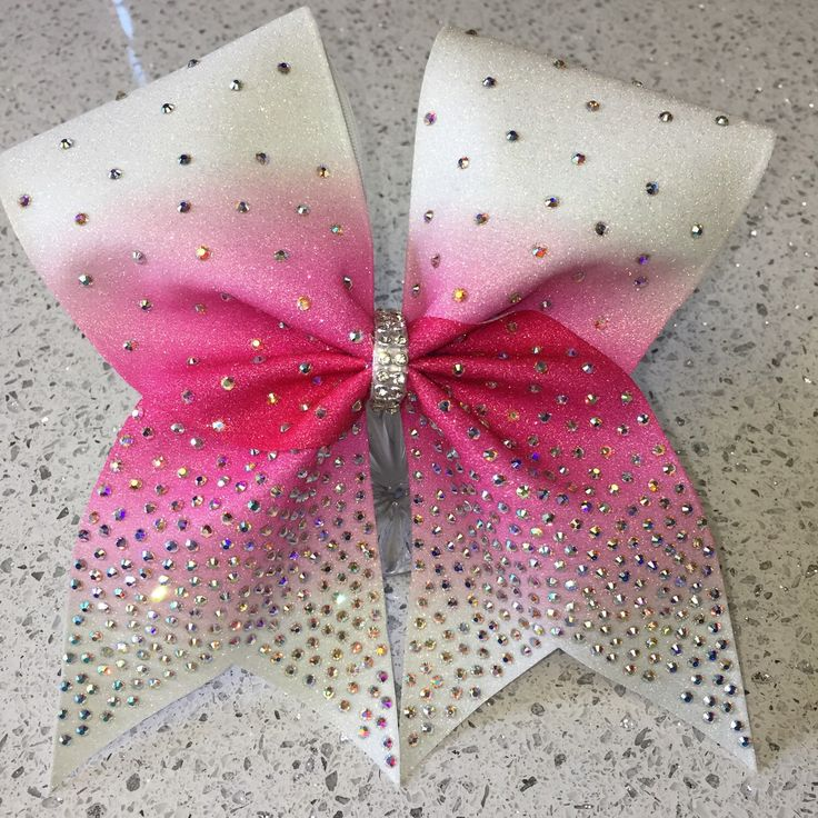 A personal favorite from my Etsy shop https://www.etsy.com/listing/252473519/rhinestone-cheer-bow-pink-bow