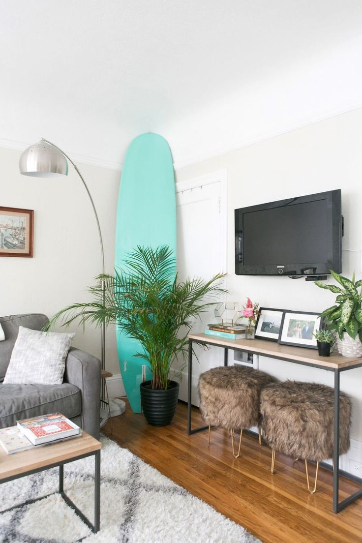 Best 25 surfboard decor ideas on pinterest used surfboards how one couple made their 700 square foot apartment feel so much bigger amipublicfo Images