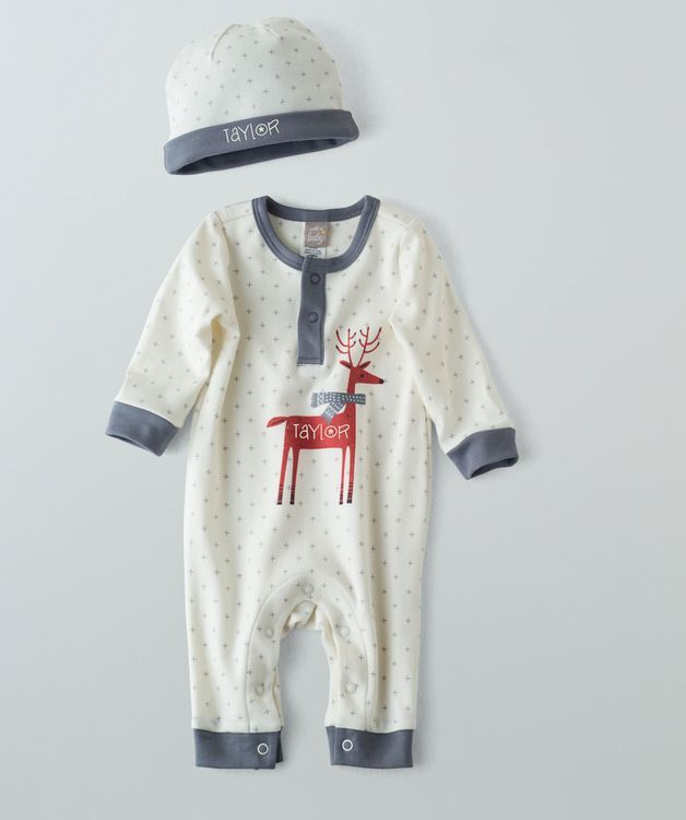 Here's a handsome reindeer ready for some fun in the sun and snow! This artist-created reindeer character covers the front of this pattern romper made from ink-based dyes that last for lots of washes. The design is complimented perfectly with gray cuffs and neckline and plenty of classic snaps for quick change outs. The beanie style hat features the same understated pattern and keeps your little's head protected from all types of cold temperatures and wind. A Hallmark Baby exclusive!