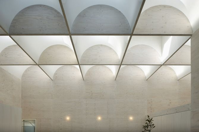 """soft and diffused lighting TAKESHI HOSAKA, DAYLIGHT HOUSE: """"light from 29 skylights (approx 700mm square) installed in the roof illuminate the room as soft light diffused through the curved acrylic ceiling plates."""""""