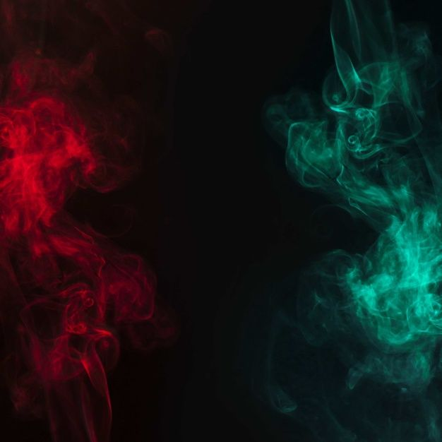 Abstract Red And Green Smoke Flowing Over The Black Background Smoke Wallpaper Red And Black Background Black And Blue Wallpaper