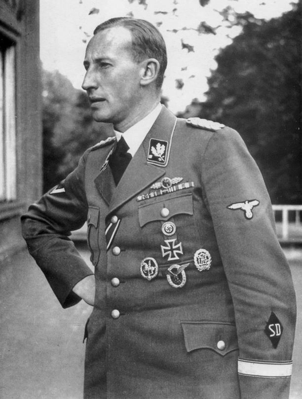 Reinhard Tristan Eugen Heydrich (7 March 1904 – 4 June 1942)  SS-Obergruppenführer (General) and General der Polizei, chief of the Reich Main Security Office (including the Gestapo, Kripo, and SD) and Stellvertretender Reichsprotektor (Deputy/Acting Reich-Protector) of Bohemia and Moravia. Thankfully assassinated by Czech patriots.