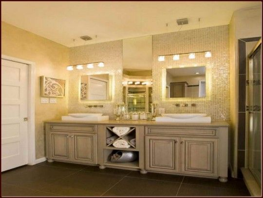 Bathroom-vanity-cabinets-with-double-sink-and-lighting-fixtures-over-mirror