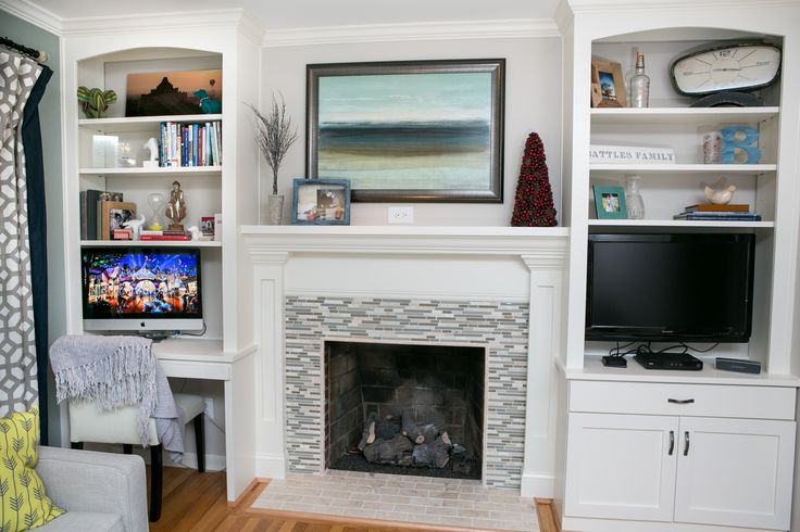 Living room + office combination. Built-in bookshelves/desk/TV space and custom fireplace surround.