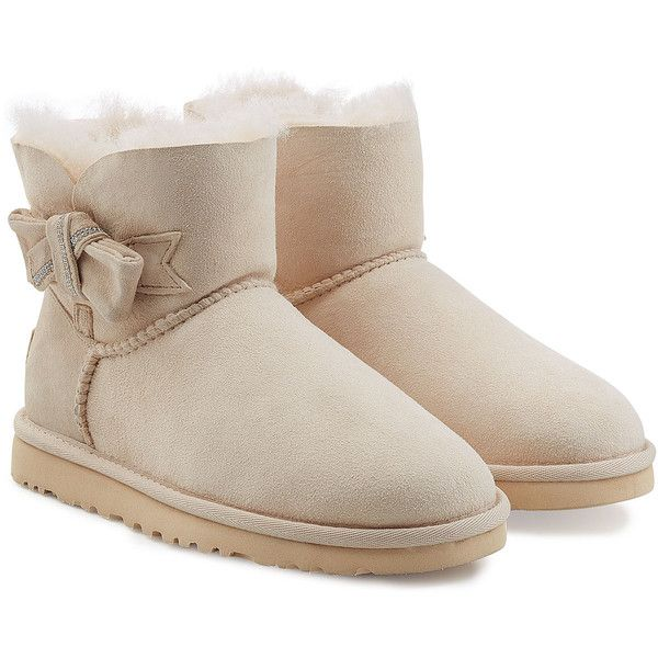 UGG Australia Jackee Embellished Sheepskin Boots (830 RON) ❤ liked on Polyvore featuring shoes, boots, white, decorating shoes, sheepskin boots, sheeps boots, bow boots and ankle high boots