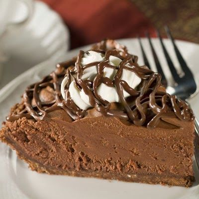 Chocolate Lover's Chocolate Mousse Pie has a chocolate crust with a milk chocolate coating, fluffy chocolate filling, whipped cream and is topped with a chocolate drizzle.