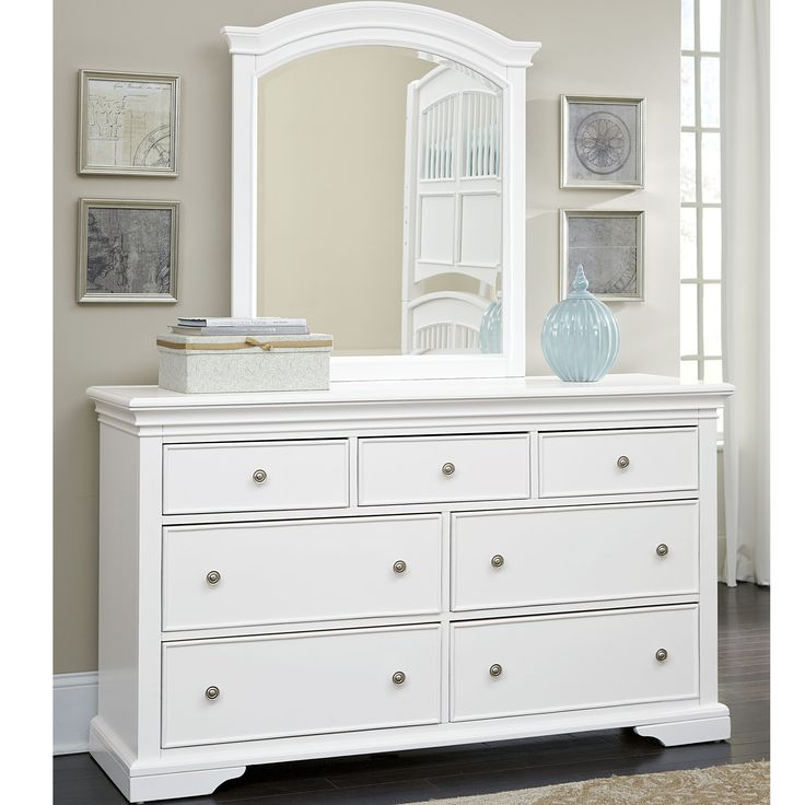 Organize clothes easily with this wood dresser. This attractive furniture coordinates easily with most decors, and the integrated mirror lends a beautiful touch. Removable dividers in the top left and