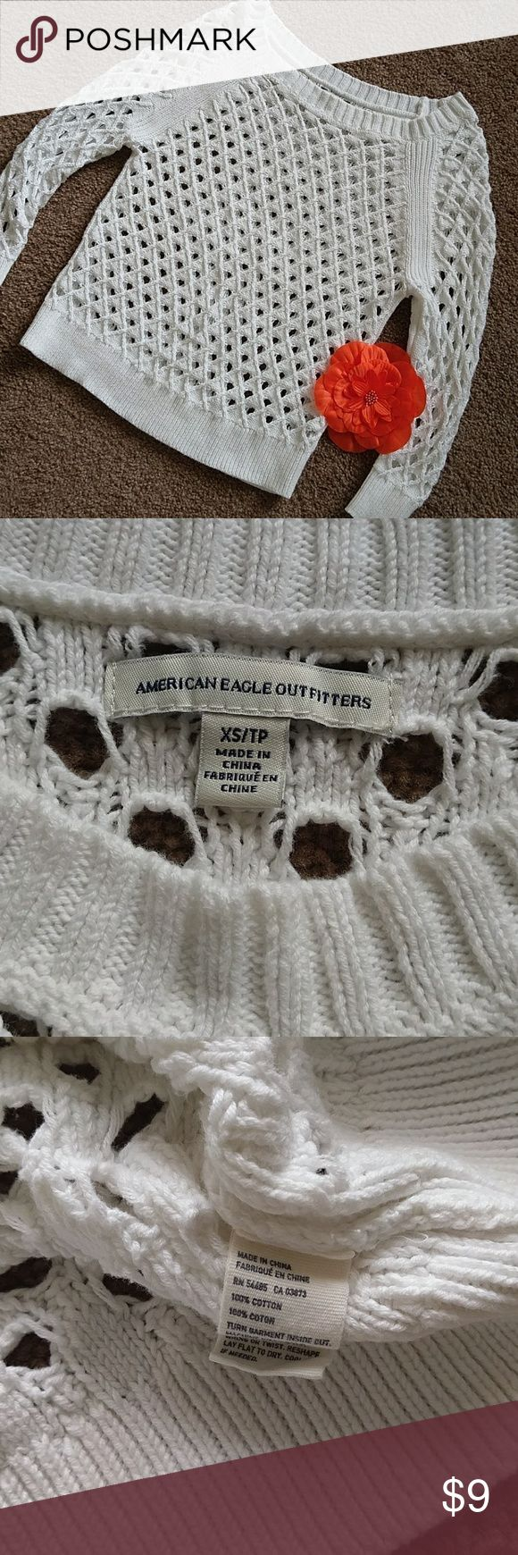 AMERICAN EAGLE WHITE OPEN WEAVE 3/4 SLEEVE TOP White open weave pullover sweater top. 3/4 sleeves. Gently worn. Bundle with other items for discount! American Eagle Outfitters Tops