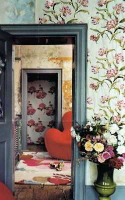 Rooms layered in wallpaper.