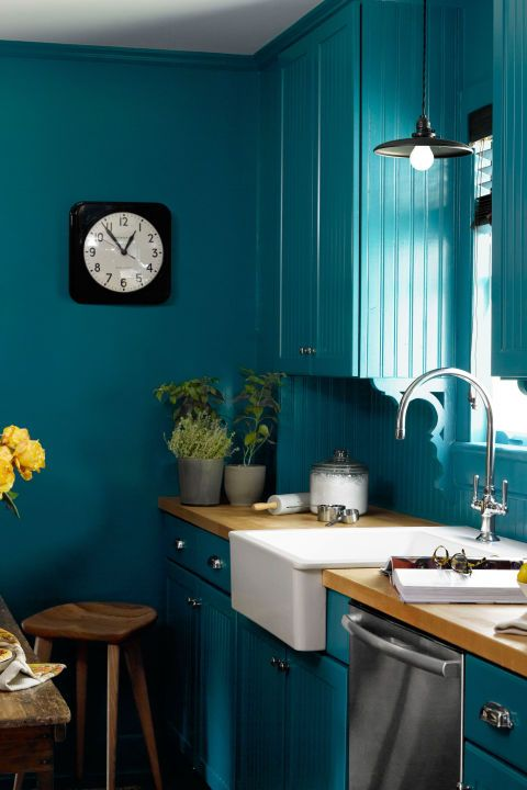 A vibrant shade of teal or aquamarine can inject brightness into a dark space. Ikea's white farmhouse sink pops against the high-gloss blue covering the kitchen walls, cabinets, and trim in this 1840s upstate New York house. The paint is Benjamin Moore's Varsity Blues.