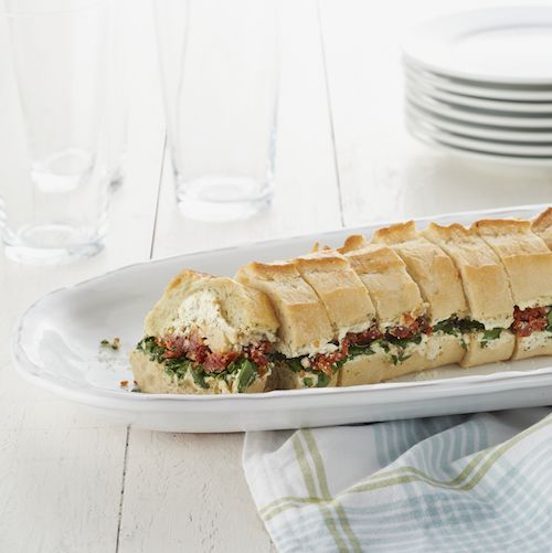 Antipasto Loaf with sun-dried tomatoes, artichoke hearts, spinach and Philly! #picnic #sandwich #share