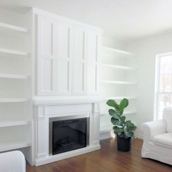 Come see how we installed a built-in electric fireplace and hidden TV nook with bi-fold doors in our living room.