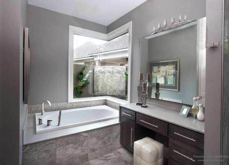 Сочетание светло-серого с темно=серым и белым в интерьере ванной комнаты