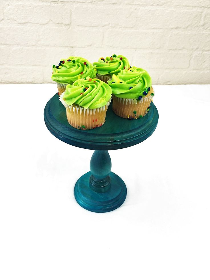 "Turquoise Round Wood Smash Cake Cupcake Stand Display Pedestal. Please read our listing in full for policies and shipping times as well as dimensions of each item. Round wood cake stand or display riser. This piece has so many uses and is a beautiful accessory on any table. Use as a cupcake stand, cake stand, display riser or a multitude of other uses. This solid wood cake stand is 6"" with a routed edge and stands 8"" tall. The stain shown here is a water based stain in turquoise, but we…"