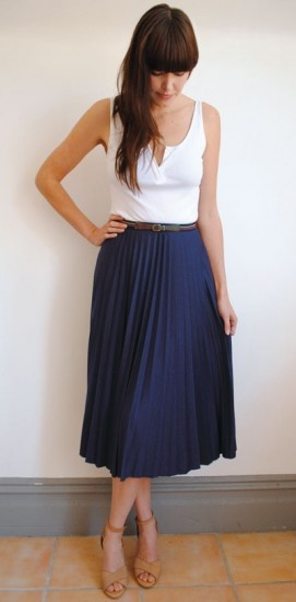 Simple white tank paired with navy accordion pleat midi skirt with a skinny belt and heels. Win.