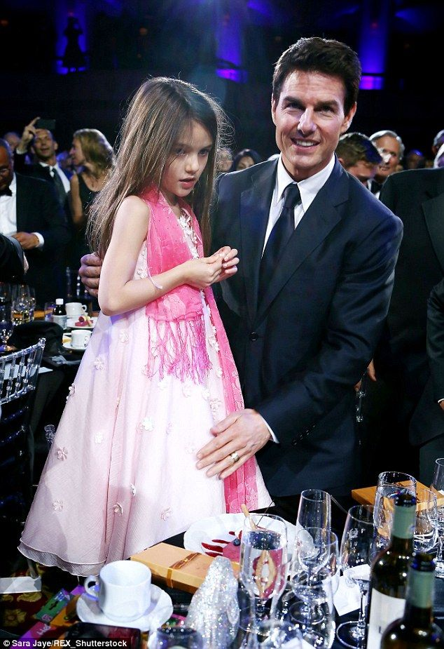 Daddy's girl: Tom Cruise took Suri with him when he was honoured with theFriars Club Ente...
