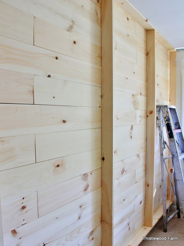 1 by 6's mimic the look of shiplap in an old house.  Then they added a second layer of 1 by 4's to create shelves.