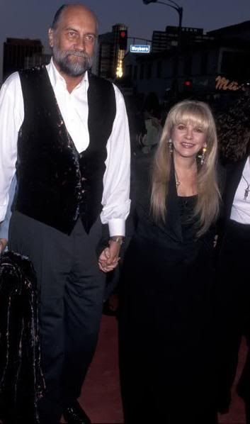 Stevie Nicks with Mick Fleetwood. I didn't realize, until I read Mick's bio, that he is 6'6 and Stevie is 5'1. There really is that much of a height difference!
