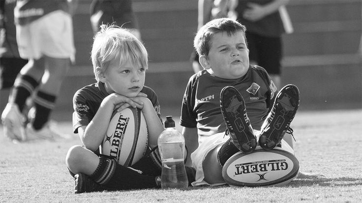 Great Photo- This looks like Kannon everywhere we go. Never goes anywhere without his rugby ball :)