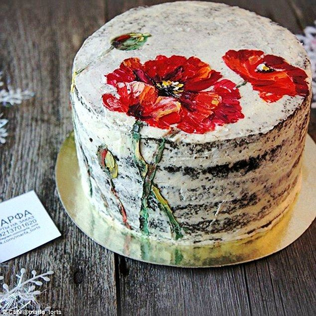 This beautiful gateau has a poppy design with a stem iced onto the side of the cake...