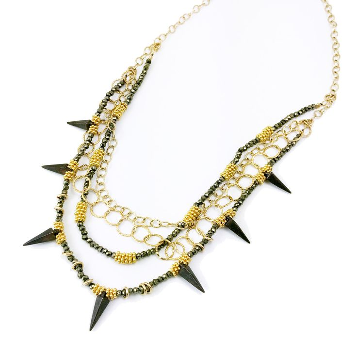 Mabel Chong Toulouse Necklace This stunning necklace combines 14k gold fill chains and beads with pyrite beads and oxidized sterling points. $365
