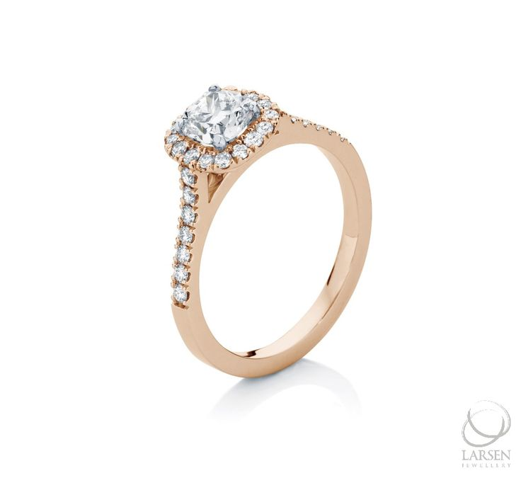 R O S E T T A   Micro-claw halo engagement ring in 18ct Rose Gold, set with thirty small Brilliant cut diamonds, and a centre 0.76ct Cushion cut diamond.  #larsenjewellery #rings #engagementrings #rosegold #halorings #jewellery #jewelry #diamonds #diamondrings #love