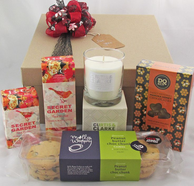 Divine Pamper Womens - Funky Gifts. It's easy to make her smile with this beautiful gift box. Includes fresh Citrus scented candle, Rose scented body lotion, Rose scented soap, Manuka Honey chocolates, Choc chunk cookies.