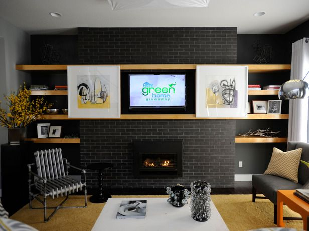 amazing fireplace with built in shelves and artwork the slides open to reveal a TV