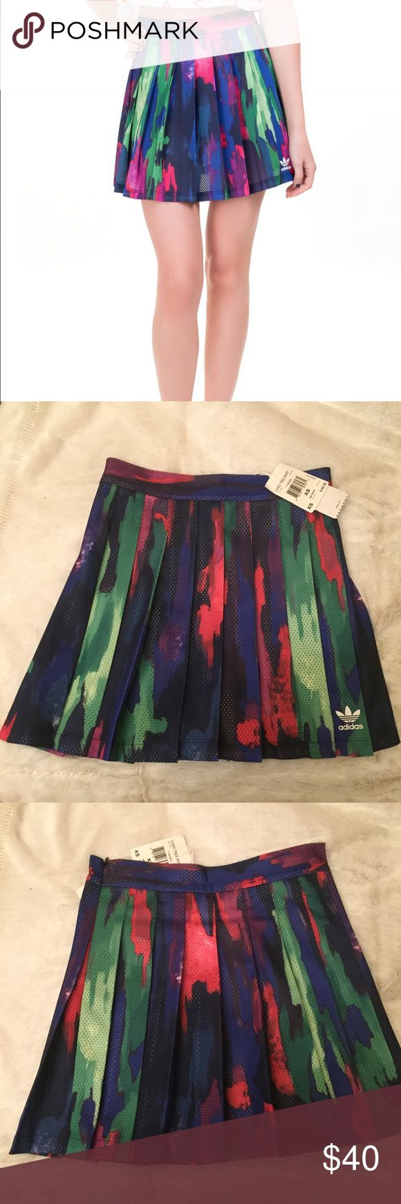 """Adidas Originals Pharrell Camo Tree Skirt New with tags size XS. Never worn. Excellent condition. Pharrell Williams for Adidas Camo Tree skirt. Has colors of purple, pink, green. Multi color. Perfect for tennis. Size zipper.  Techno fabric. Pleated detailing. Logo on front bottom of skirt. Unlined.  Composition: 100% Polyester Flat lay measurement: 12"""" waist. 15"""" Length adidas Skirts Mini"""