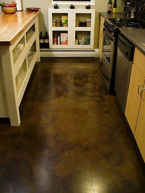 Acid-dyed concrete - becoming increasingly popular (coffee shops and west coast home) low maintenance and indestructible - designed to mimic a natural outside surface and conceal wear and dirt (solid colors show wear easier)