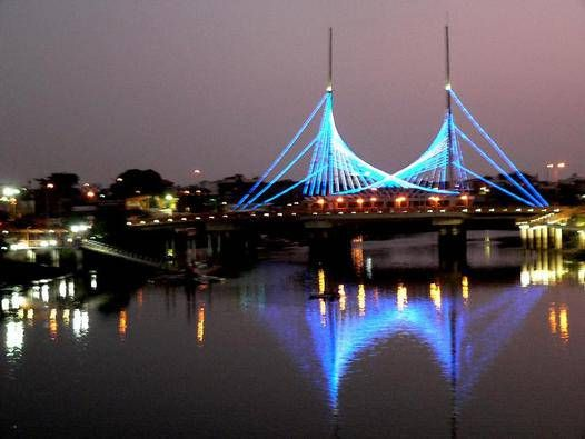 "Velero Bridge, also known as ""El Velero"", is a bridge in Guayaquil, Ecuador. One of the prominent landmarks of the city, especially when lit up at night, it was inaugurated on July 27, 2005. It forms part of the route of the Guayaquil Marathon."