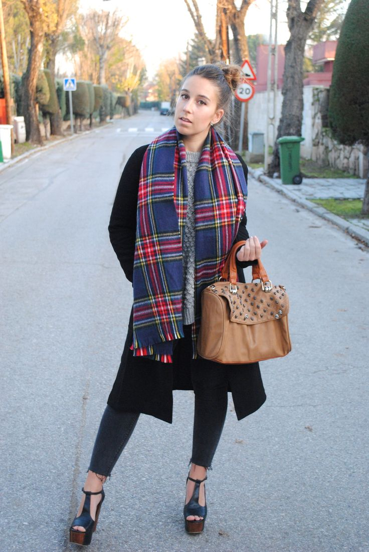 Shop this look on Lookastic:  http://lookastic.com/women/looks/cable-sweater-coat-tote-bag-skinny-jeans-heeled-sandals-scarf/7278  — Grey Cable Sweater  — Black Coat  — Brown Studded Leather Tote Bag  — Charcoal Skinny Jeans  — Black Chunky Leather Heeled Sandals  — Navy Plaid Scarf