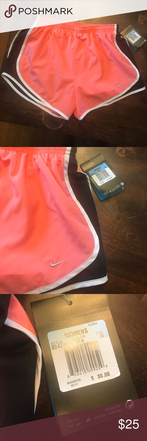 Women's Nike shorts New with tags Nike shorts! Size M. Coral color and black Nike Shorts