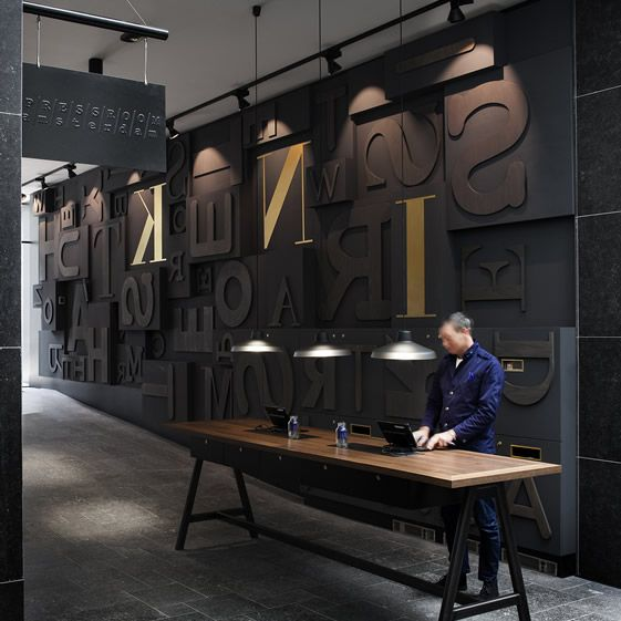 From notepad to news-stand, the whole De Tijd operation was run from the premises, and Dutch creative studio concrete has done a fine job translating the spirit of the old business into a modern proposition...